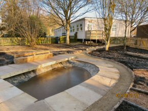 Paved area around newly formed pond