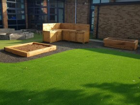 Mud kitchen raised beds and artificial grass at Hamp Junior School, Bridgwater